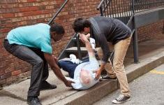 stock-photo-21383998-two-young-men-helping-fallen-down-senior-multi-ethnic